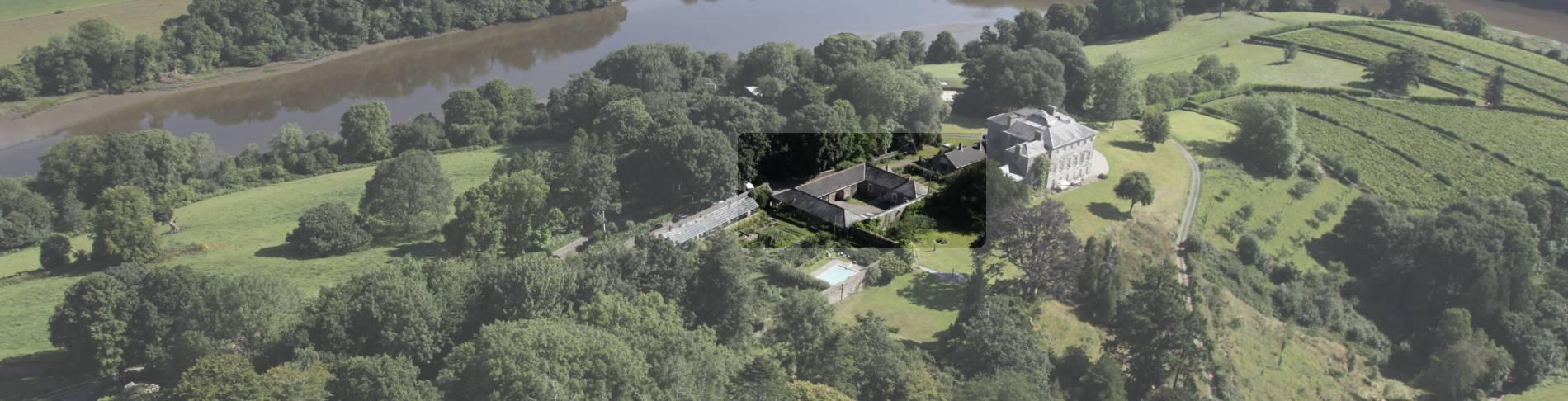 Overhead shot of The Coach House behind Sharpham House