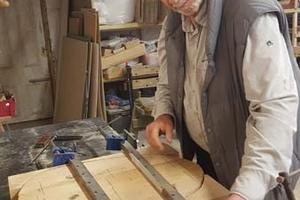 Volunteer Rick works on a bench seat