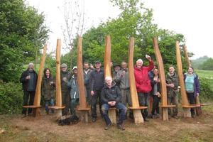 The finished bench with artist Peter Lanyon and the team of volunteers