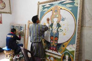 Religious paintings being produced by master craftsmen