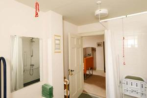 The ensuite bathroom to the Clare Milne Room - our accessible bedroom