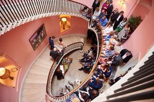 The elliptical stairwell provides a memorable wedding